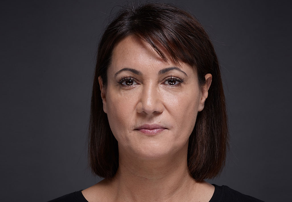 Woman face with brown eyes on grey background | Fillmed